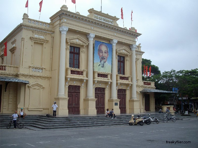 Locals relaxing on the steps of Hai Phong Opera House