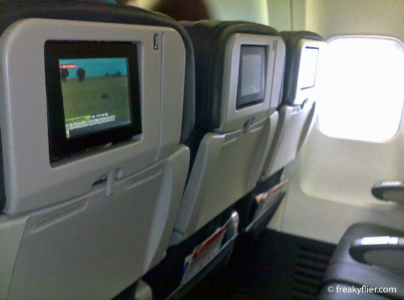 Seating with seat back TV screens