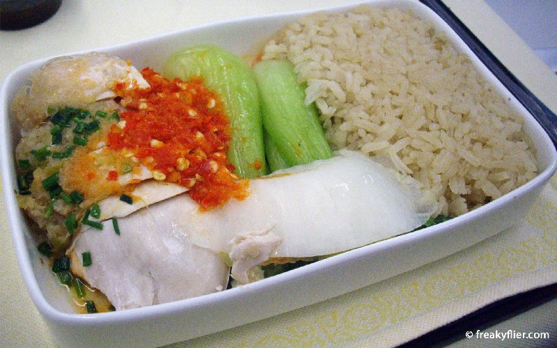 Main course, Hainan Chicken Rice, served hot