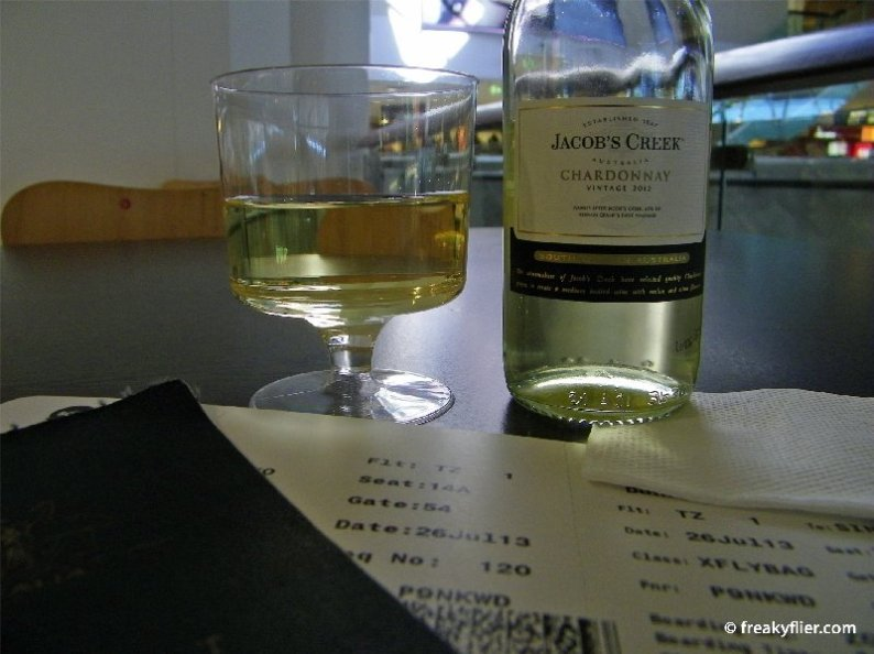 ScootBiz boarding pass with a piccolo of wine purchased prior to departure