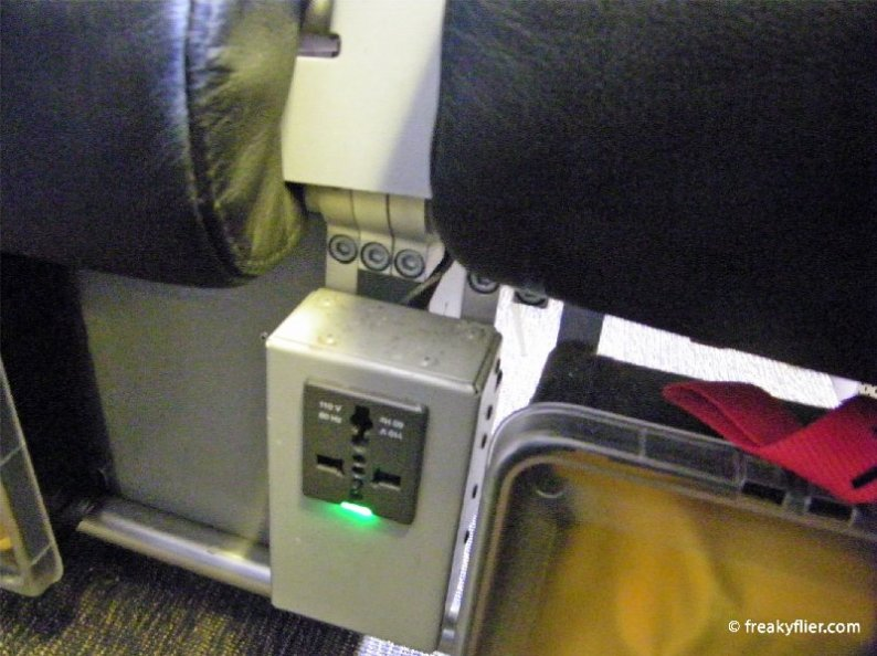 In-seat power located between seats
