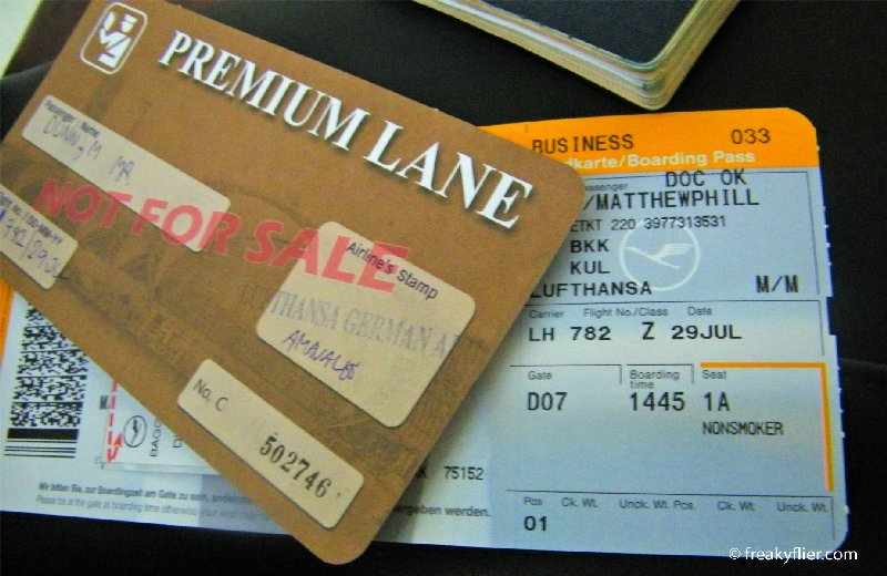 Business Class boarding pass and Premium Lane pass