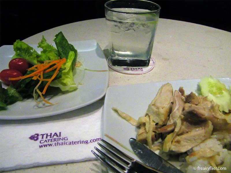Hainanese chicken rice, salad and iced water with lime