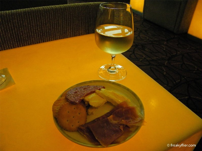 Charcuterie and cheeses with a white wine in the Singapore Airlines KrisLounge, Bangkok Airport