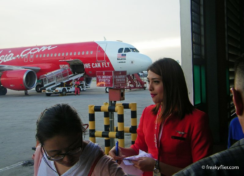 Boarding passes are checked at the entry to the tarmac prior to boarding the aircraft