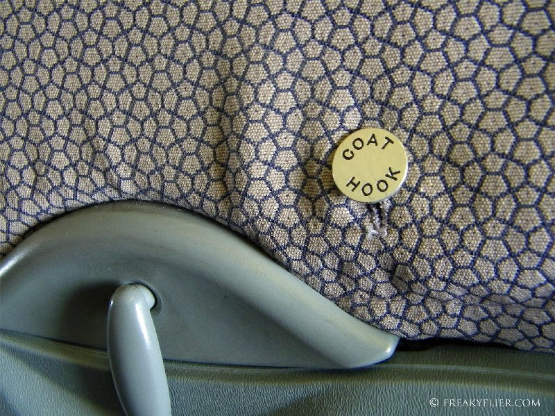 Very retro coat hook on a Business Class seat back on Qantas Airways 737-400