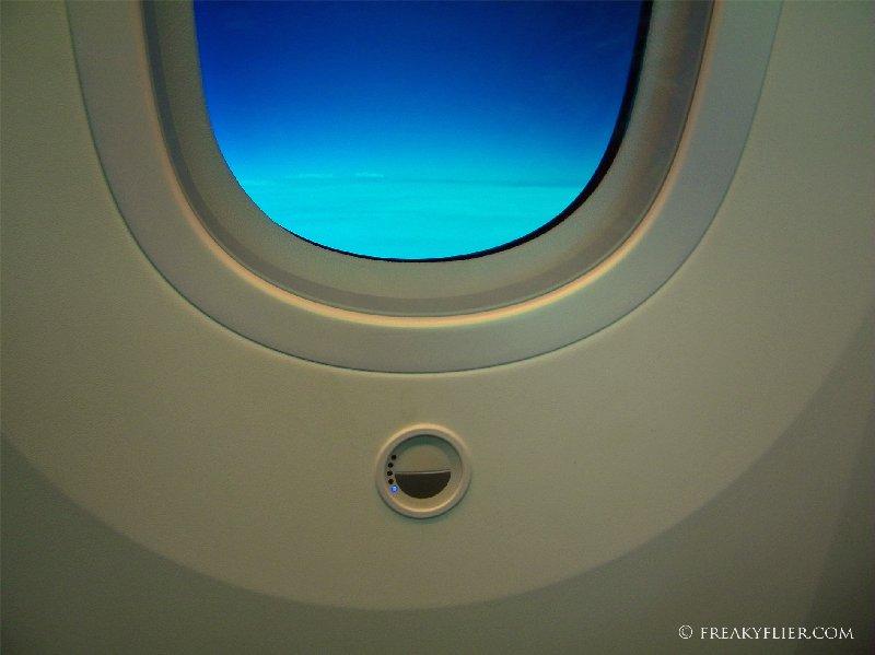 Touch button to lighten or darken the window tinting