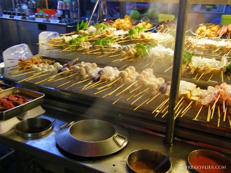 The street vendors display a huge choice of food on sticks!
