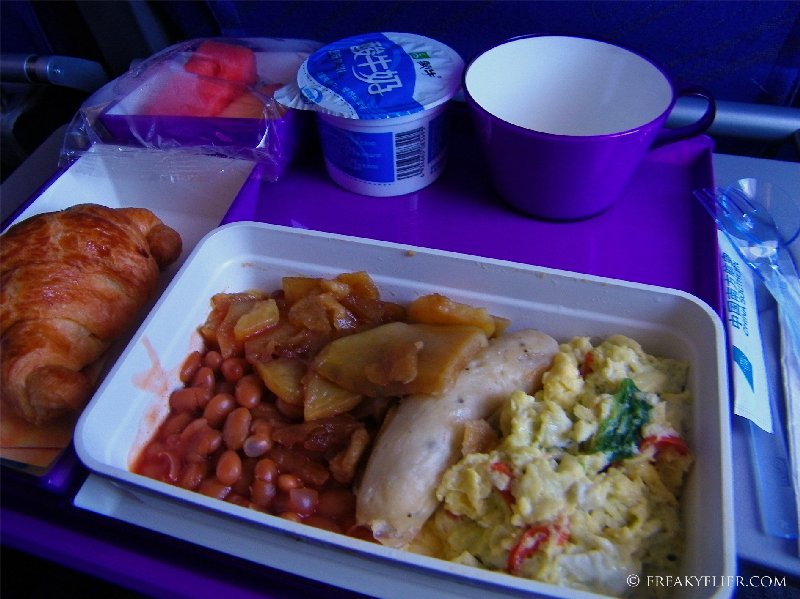Western breakfast - Chicken sausage, scrambled eggs and baked beans with a croissant
