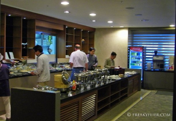 Hot and cold food buffet with many asian and western choices