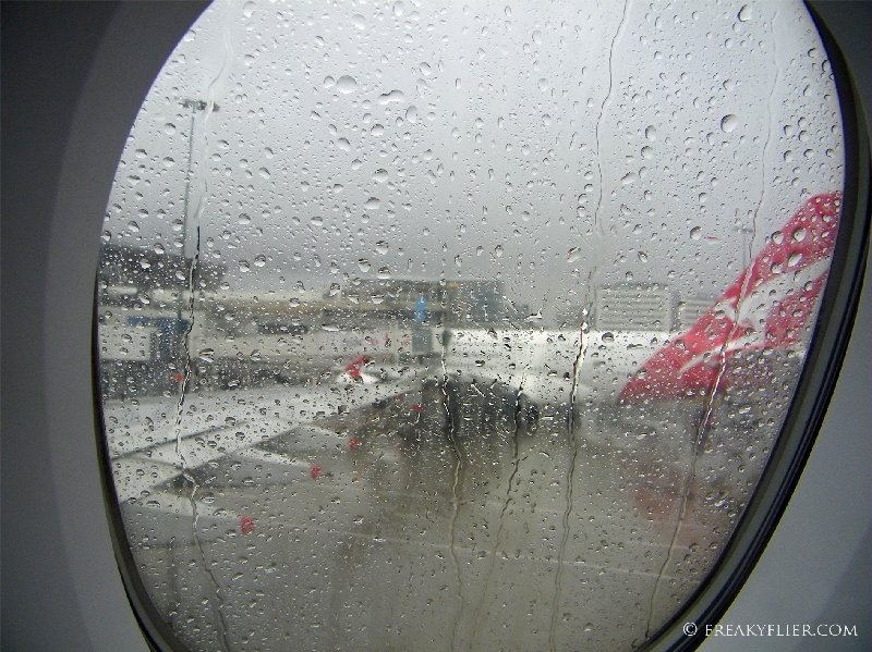 Arrival in a wet Sydney and parked next to a Qantas a380