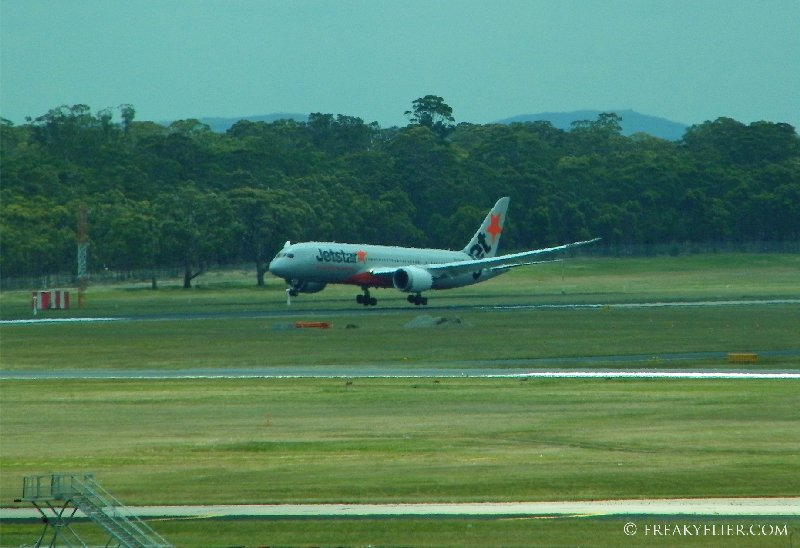 Jetstar's Boeing 787 Dreamliner lands at Melbourne Airport as viewed from the Qantas Club