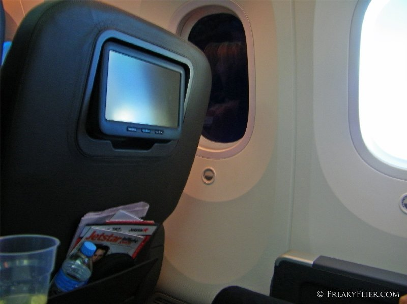 Business Class seat with one window tinted on Jetstar's 787