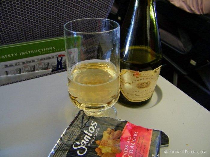 Champagne on board Qantas Economy to Melbourne