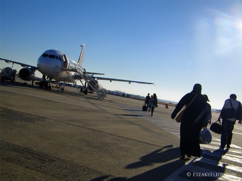 Walking across the tarmac to the awaiting aircraft