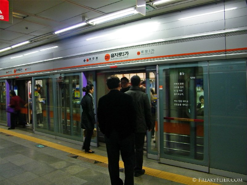 Orderly boarding at a Seoul subway station