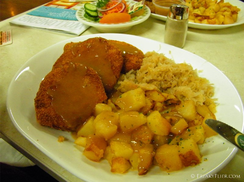 Kasseler - crumbed slies of rost pork loin with potato and sauerkraut. Large - $19