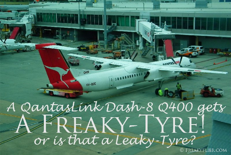 A QantasLink Dash-8 Q400 gets a FREAKY-TYRE or is that a Leaky Tyre?