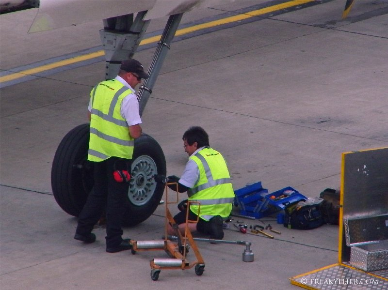 Tightening the bolts on the new tyre inplace on the Dash-8 Q400