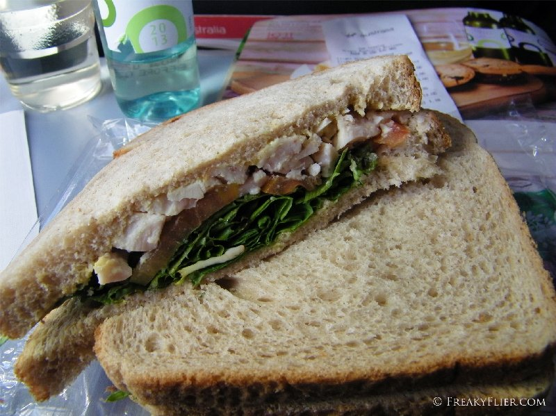 The mustard chicken and salad sandwich with white wine