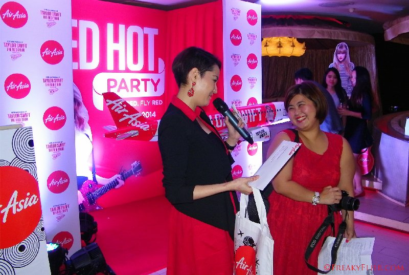 Yasmin Hani hands out prizes to a few lucky guests