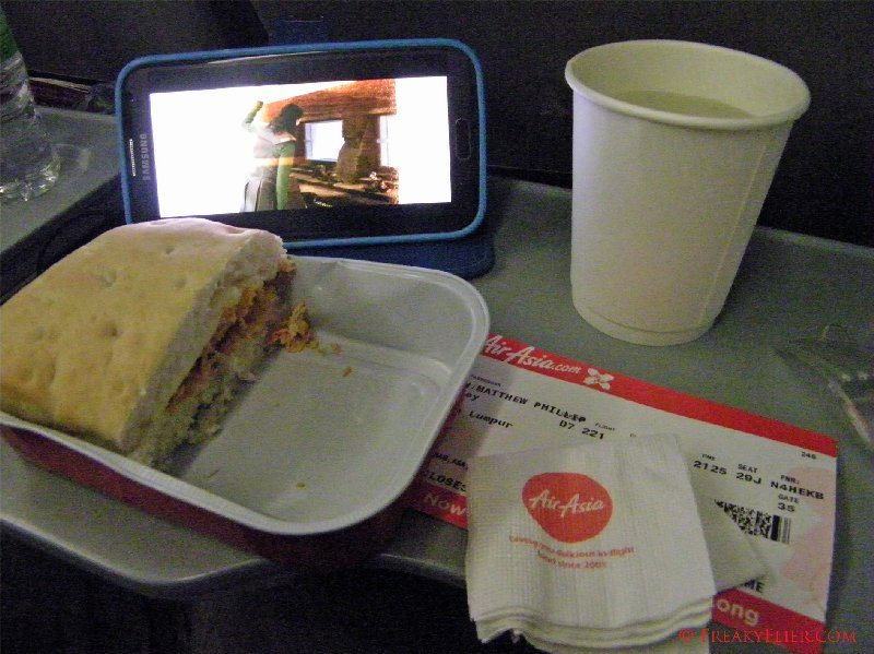 Dinner and a movie on board Air Asia X to Kuala Lumpur