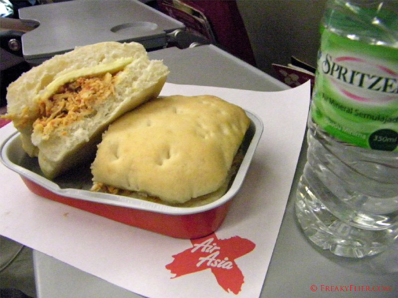 Chicken roll and water on board Air Asia X