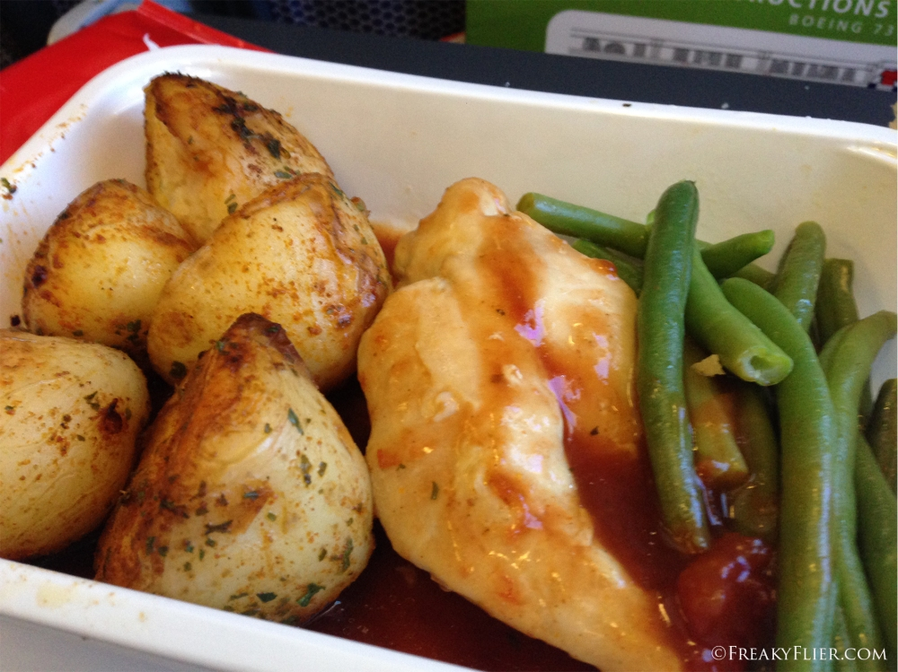 Roasted chicken, potatos and beans on board Qantas to Sydney