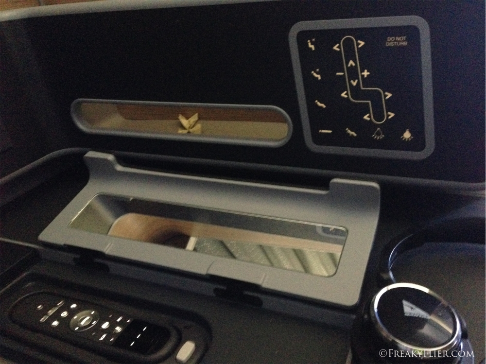 AVOD and seating controls and handy mirror