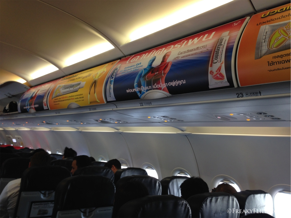 Paid advertising on the overhead bins on Thai Air Asia