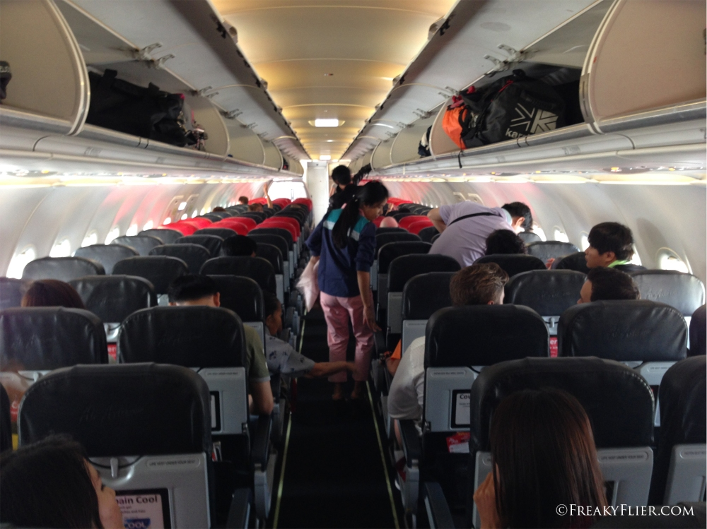Settling in for the flight on board Air Asia to Mandalay