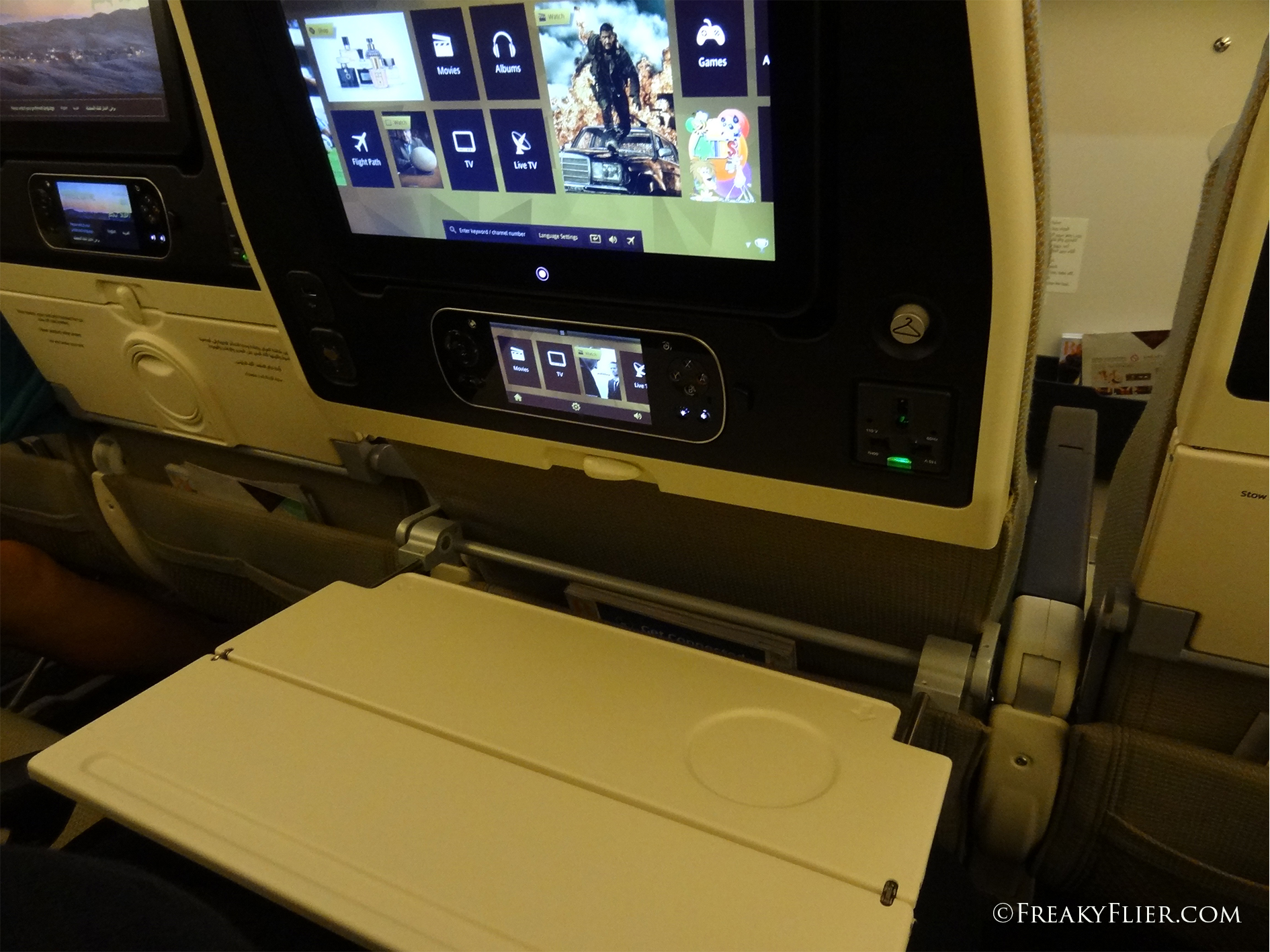 Economy Class AVOD screen and remote screen plus bi-folding tray table