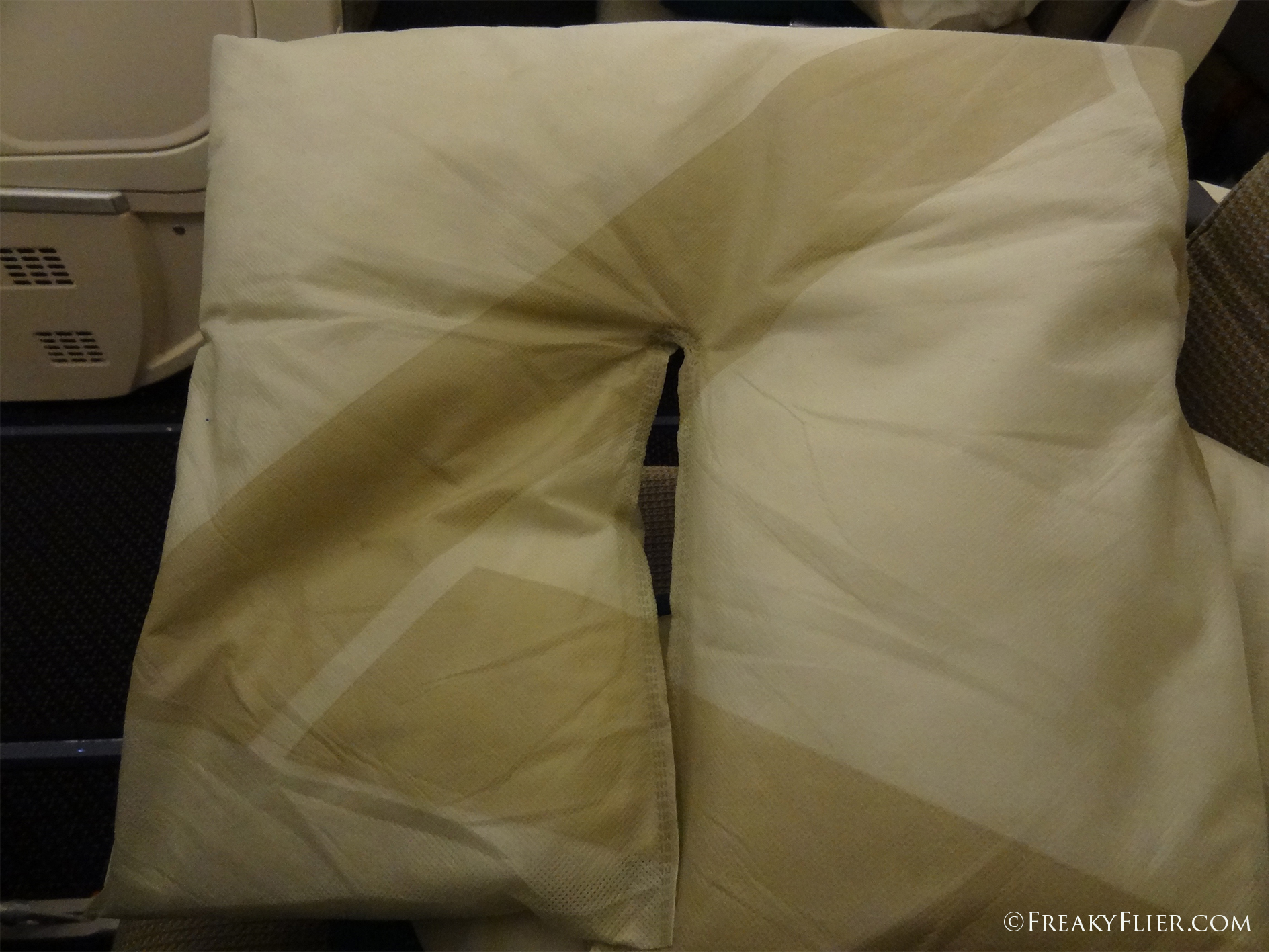 Economy Class pillow that doubles as a neck cushion