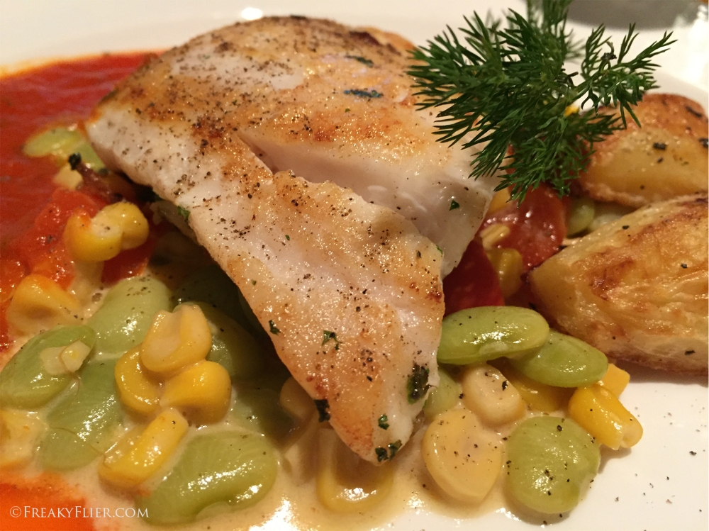 Sauteed Red Snapper on Marinara and Basil Sauce with succotash and roasted potatos