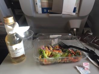 Chicken Cobb Salad and wine.